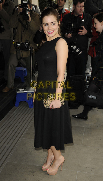 Rachel Shenton.The TRIC ( TV & Radio Industries Club ) Awards, Grosvenor House Hotel, London, England..March 13th, 2012.full length black dress sleeveless beige shoes side clutch bag leopard print .CAP/CAN.©Can Nguyen/Capital Pictures.