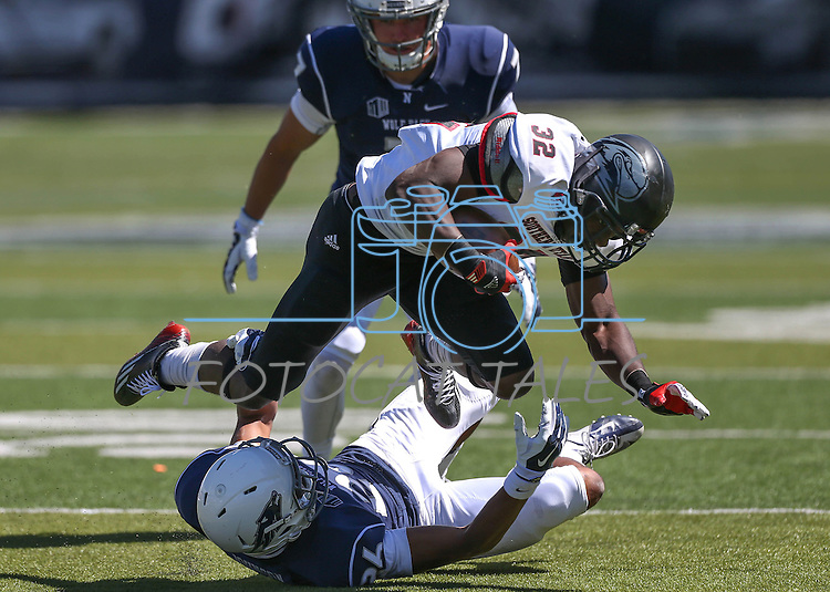 Southern Utah's Raysean Pringle (32) runs over Nevada defender Kendall Johnson (26) during the second half of an NCAA college football game on Saturday, Aug. 30, 2014 in Reno, Nev. Nevada's Duran Workman (7) is at rear. (AP Photo/Cathleen Allison)