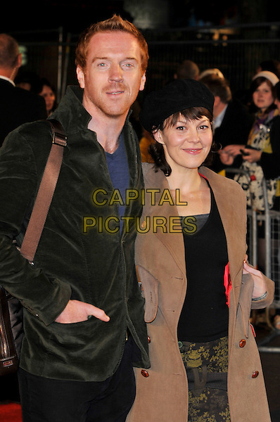"DAMIAN LEWIS & HELEN McCORY.2009 London Film Festival - Times Gala & the UK Premiere of ""The Men Who Stare At Goats"" at the Odeon, Leicester Square, London, England..October 15th 2009 .half length married husband wife brown coat green jacket black hat beret hand in pocket damien stubble facial hair .CAP/PL.©Phil Loftus/Capital Pictures."