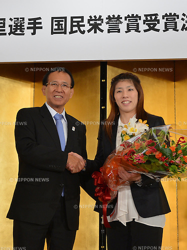 "October 23, 2012, Tokyo, Japan - Saori Yoshida, right, Japan's three-time Olympic wrestling champion, shakes hands with Tomiaki Fukuda, president of the Japan Wrestling Fedreation, following a news conference in Tokyo on Tuesday, October 23, 2012. Japanese government decided to bestow the People's Honor Award on her for ""bringing hope and courage to society."" Yoshida,30, won a total of 13 Olympic and world titles in women's wrestling.  (Photo by Natsuki Sakai/AFLO) AYF -mis-"
