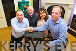 Michael G. Kenny from Killorglin being presented with a Henley Stove on Monday at Fitzgibbon Brother Interiors, Tralee. Michael was the overall winner of a competition run by Radio Kerry in conjunction with Fitzgibbon Brother Interiors. Pictured from left: Michael G. Kenny, Michael Kenny, Sharon O'Mahony and Neil Fitzgibbon.