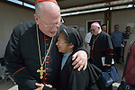 Cardinal Timothy Dolan, the archbishop of New York, embraces a Sacred Heart Sister from India at the St. Joseph Clinic run by the Chaldean Archdiocese of Erbil in Ankawa, Iraq, on April 9, 2016. Dolan, chair of the Catholic Near East Welfare Association, was in Iraqi Kurdistan to visit with Christians and others displaced by ISIS. CNEWA is a papal agency providing humanitarian and pastoral support to the church and people in the region.