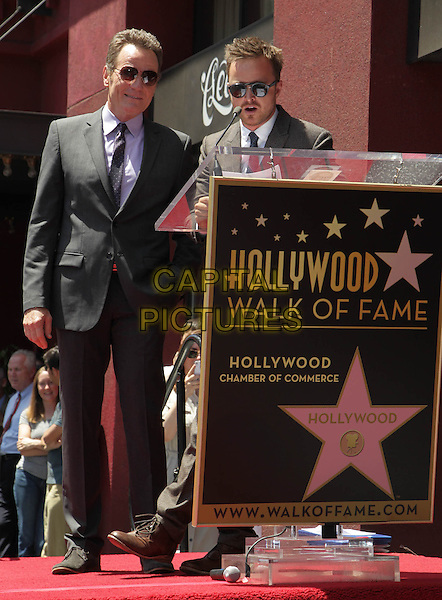 Bryan Cranston, Aaron Paul<br /> Bryan Cranston honored with star on The Hollywood Walk of Fame, Hollywood, California, USA.<br /> July 16th, 2013<br /> full length black suit sunglasses shades podium speech   <br /> CAP/ADM/KB<br /> &copy;Kevan Brooks/AdMedia/Capital Pictures