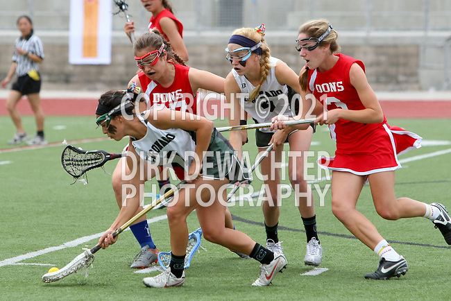 San Diego, CA 05/21/11 - Lauren Maack (Coronado #4), Michaela Guerrera (Coronado #7), Krystyn Berretta (Cathedral Catholic #3) and Sharia Smith (Cathedral Catholic #27) in action during the 2011 CIF San Diego Division 2 Girls lacrosse finals between Cathedral Catholic and Coronado.