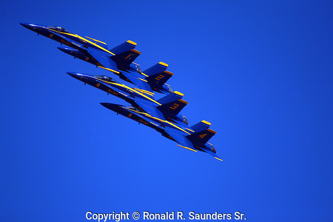 The BLUE ANGELS in FORMATION<br /> <br /> They fly F/A-18 Hornets at air shows and special events to boost recruiting for both the United States Navy and the Marine Corps.The United States Navy's Navy Flight Demonstration Squadron, popularly known as the Blue Angels,first performed in 1946 and is currently the oldest formal flying aerobatic team. They fly F/A-18 Hornets at air shows and special events to boost recruiting for both the United States Navy and the Marine Corps.<br /> (16)