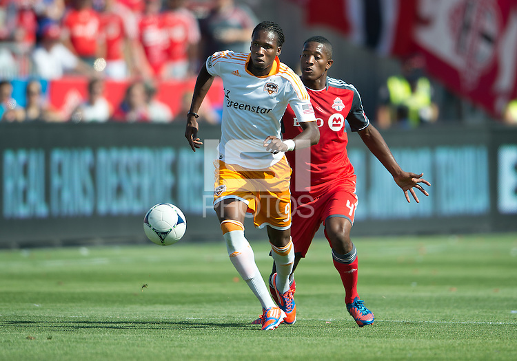 July 28, 2012: Houston Dynamo midfielder/forward Macoumba Kandji #9 and Toronto FC defender Doneil Henry #4 in action during a game between Toronto FC and the Houston Dynamo at BMO Field in Toronto, Ontario Canada..The Houston Dynamo won 2-0.