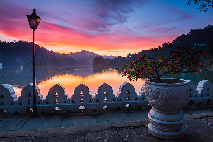 Dramatic sunrise at Kandy Lake and the Clouds Wall (Walakulu Wall), Kandy, Central Province, Sri Lanka, Asia. This is a photo of a dramatic sunrise at Kandy Lake and the Clouds Wall (Walakulu Wall) in Kandy, Central Province of Sri Lanka, Asia. Kandy is the second largest city in Sri Lanka, and is home to beautiful Kandy Lake and Clouds Walls (Walakulu Wall), a great place to visit for a walk at sunrise. The Sacred City of Kandy is one of eight UNESCO World Heritage Sites in Sri Lanka.