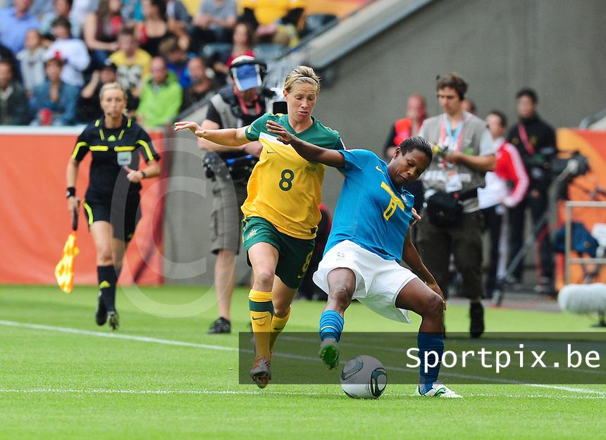 Fifa Women's World Cup Germany 2011 : Brazil - Australia  at Borussia - Park in Munchengladbach : Formiga schermt de bal af voor Elise Kellond-Knight.foto DAVID CATRY / Vrouwenteam.be