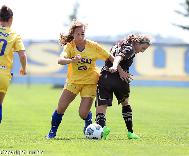 BROOKINGS, SD - AUGUST 13: Annie Williams #23 from South Dakota State controls the ball past Sara Schur #11 from Manitoba during the first half of their exhibition match Sunday afternoon at Fishback Soccer Park in Brookings. (Photo by Dave Eggen/Inertia)