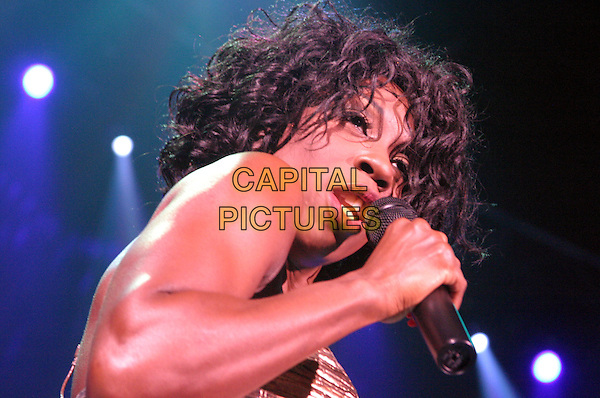 HEATHER SMALL .M People .plays Nottingham Arena..UK, United Kingdom..Ref: JEZ.30th September 2005.portrait headshot M People live on stage performing gig sing singing mpeople m-people holding microphone curls curly waves tousled hair.www.capitalpictures.com.sales@capitalpictures.com.©Capital Pictures.