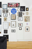 The living room gallery wall includes work by contemporary Dutch artists, antique Spanish religious artefacts such as a crown of thorns, a Grayson Perry vase and a Gavin Turk edition.