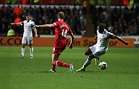 Pictured: Wayne Routledge of Swansea (R) against Steven Gerrard of Liverpool (L)<br />
