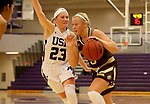 SIOUX FALLS, SD - NOVEMBER 25: Caleigh Rodning #5 from Southwest Minnesota State University drives against Jacey Huinker #23 from the University of Sioux Falls during their game Saturday evening at the Stewart Center in Sioux Falls. (Photo by Dave Eggen/Inertia)