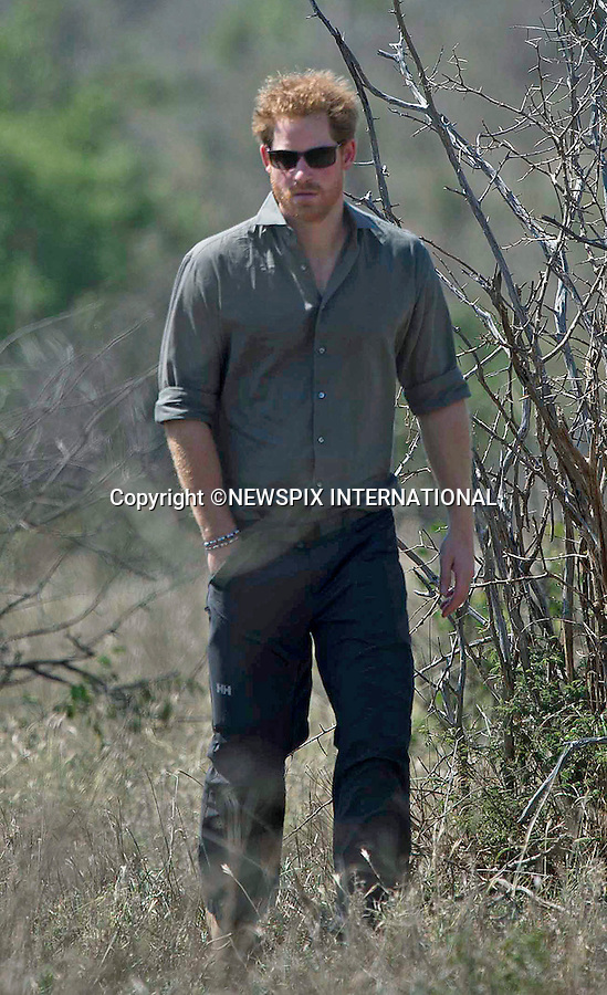 02.12.2015;Kruger, South Africa: PRINCE HARRY<br />visits a crime scene of a rhino  killed by poachers in Kruger National Park South Africa with members of the the forensic team.<br />Mandatory Photo Credit: &copy;NEWSPIX INTERNATIONAL<br /><br />PHOTO CREDIT MANDATORY!!: NEWSPIX INTERNATIONAL(Failure to credit will incur a surcharge of 100% of reproduction fees)<br /><br />IMMEDIATE CONFIRMATION OF USAGE REQUIRED:<br />Newspix International, 31 Chinnery Hill, Bishop's Stortford, ENGLAND CM23 3PS<br />Tel:+441279 324672  ; Fax: +441279656877<br />Mobile:  0777568 1153<br />*All Fees Payable to Newspix International*<br />e-mail: info@newspixinternational.co.uk