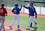 Western Nevada College's head coach D.J. Whittemore congratulates Tyler Baker after his 1-run single ties score in a college baseball game against Colorado Northwestern in Carson City, Nev., on Sunday, March 10, 2013. WNC swept the weekend series 4-0..Photo by Cathleen Allison