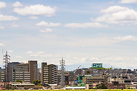 Mount Fuji sen in the distance over the apartment buildings and houses of suburban Tokyo, Japan, Sunday, May 20th 2018