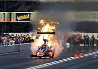 Feb. 15, 2013; Pomona, CA, USA; NHRA top fuel dragster driver David Grubnic explodes an engine on fire during qualifying for the Winternationals at Auto Club Raceway at Pomona. Mandatory Credit: Mark J. Rebilas-