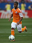 Houston Dynamo midfielder Corey Ashe (26) in action during the game between the FC Dallas and the Houston Dynamo at the FC Dallas Stadium in Frisco,Texas.