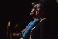 CALI - COLOMBIA. 14-08-2019: Mujeres miran la presentacvión de los grupos autóctonos del Pacífico durante el primer día del XXIII Festival de Música del Pacífico Petronio Alvarez 2019 el festival cultural afro más importante de Latinoamérica y se lleva acabo entre el 14 y el 19 de agosto de 2019 en la ciudad de Cali. / A women look the performance of autochthonous Pacific music during the XXII Pacific Music Festival Petronio Alvarez 2019 that is the most important afro descendant cultural festival of Latin America and takes place between August 14 and 19, 2019, in Cali city. Photo: VizzorImage/ Gabriel Aponte / Staff