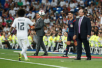 Real Madrid´s coach Benitez talks to Marcelo Vieira during Santiago Bernabeu Trophy match at Santiago Bernabeu stadium in Madrid, Spain. August 18, 2015. (ALTERPHOTOS/Victor Blanco)