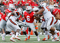Ohio State Buckeyes running back Brian Snead (6) runs between tackle attempts by Oregon State Beavers linebacker Jonathan Willis (32) and defensive tackle Elu Aydon (99) during the fourth quarter of the NCAA football game at Ohio Stadium in Columbus on Sept. 1, 2018. Ohio State won 77-31. [Adam Cairns / Dispatch]
