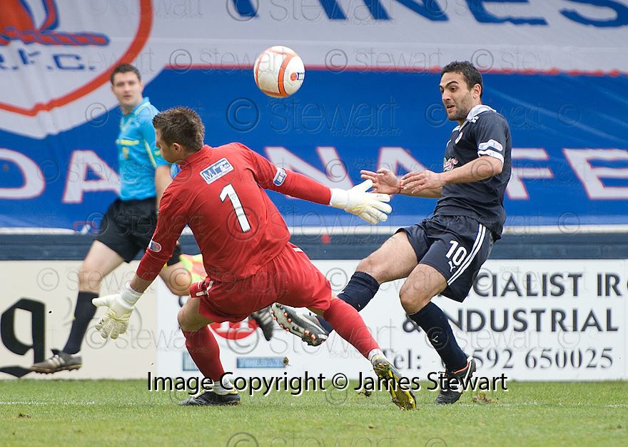 DAMAIN CASALINUOVO CHIPS THE BALL OVER ACCIES KEEPER DAVID HUTTON TO  SCORE ROVERS' FIRST