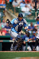 Tampa Bay Rays catcher Mike Zunino (10) tracks down a loose ball during a Grapefruit League Spring Training game against the Baltimore Orioles on March 1, 2019 at Ed Smith Stadium in Sarasota, Florida.  Rays defeated the Orioles 10-5.  (Mike Janes/Four Seam Images)