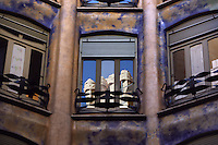Chimneys reflected into a window of the Appartment, La Pedrera (Casa Milà), Barcelona, Catalonia, Spain, built by Antoni Gaudí (Reus 1852 ? Barcelona 1926), 1906 - 1910, for the Milà Family, with Josep Maria Jujol as architect collaborator and with Joan Beltran as a plaster. One of the main Gaudi residential buildings. Picture by Manuel Cohen
