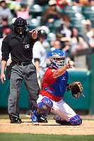 Home plate umpire Ian Fazio and Buffalo Bisons catcher Sean Ochinko (9) look to the first base umpire for a call during a game against the Louisville Bats on May 2, 2015 at Coca-Cola Field in Buffalo, New York.  Louisville defeated Buffalo 5-2.  (Mike Janes/Four Seam Images)