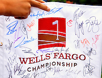 Photography of the Wells Fargo Championship, a PGA championship event held annually in Charlotte NC. The event previously was called The Wachovia Golf Championship. The event is held at the Quail Hollow Club in Charlotte, North Carolina in early May. Since its inception in 2003, the PGA golf championship event has attracted some of the top players on the tour. In 2009, the tournament had a $6.5 million purse with a winner's prize of $1.17 million. The event is often ranked among the PGA Tour's toughest holes. The majority of the charitable proceeds from the tournament benefit Teach for America.