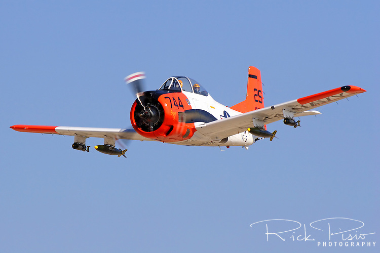A North American T-28C Trojan, Bu 140514, makes a pass upon arrival at the 2007 Warbirds in Action Airshow at Minter Field near Bakersfield, California. The T-28 was utilized as a training aircraft in the 1950'sfor the Air Force, Navy, and Marines replacing the aging World War II era T-6 trainers. One variant, the T-28D, saw action as an attack aircraft in Southeast Asia.