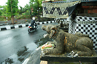Carving and small shrine at intersection. <br />