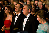United States President George W. Bush and first lady Laura Bush attend the performance of an American Celebration at Ford's Theatre in Washington, D.C. on June 25, 2006.  Sitting to the left of the President are Lisa Arpey, wife of American Airlines CEO Gerard Arpey, and Ford's Theatre producing director Paul R. Tetreault.<br /> Credit: Jay L. Clendenin - Pool via CNP