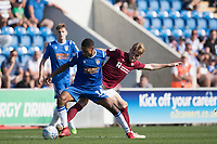 Brandon Comley of Colchester United under pressure from Ryan Watson of Northampton Town during Colchester United vs Northampton Town, Sky Bet EFL League 2 Football at the JobServe Community Stadium on 24th August 2019