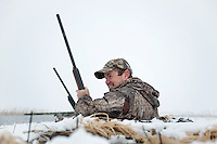 Manager of Conservation Programs in Nebraska for Ducks Unlimited Steve Donovan (cq) smiles after shooting from a blind owned by Lynn Berggren (cq) just off the duck-rich Platte River in Nebraska, Saturday, December 3, 2011...Photo by Matt Nager