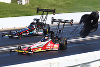 May 21, 2017; Topeka, KS, USA; NHRA top fuel driver Doug Kalitta (near) races alongside Scott Palmer during the Heartland Nationals at Heartland Park Topeka. Mandatory Credit: Mark J. Rebilas-USA TODAY Sports