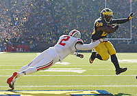 Michigan Wolverines running back Fitzgerald Toussaint (28) leaps into the end zone past Ohio State Buckeyes line backer Ryan Shazier (2)for a TD at Michigan Stadium in Ann Arbor, MI on November 30, 2013.  (Chris Russell/Dispatch Photo)