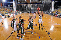 11 November 2011:  FIU's Jerica Coley (22) shoots a jump shot over Jacksonville's Chelsea Faulhaber (44) in the second half as the FIU Golden Panthers defeated the Jacksonville University Dolphins, 63-37, at the U.S. Century Bank Arena in Miami, Florida.