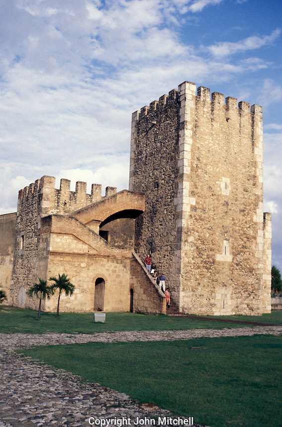 Tourists decending the steps of the Torre de Homenaje in the Fortaleza de Santo Domingo or Fortaleza Ozama, old Santo Domingo, Dominican Republic.