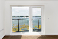 BNPS.co.uk (01202 558833)<br /> Pic: Graham Hunt/BNPS<br />  <br /> Lounge with view from the balcony window over Holes Bay<br /> <br /> Are these Britain's most sought-after council flats ...<br /> <br /> A brand new block of council flats have been unveiled that come with stunning sea views homeowners pay a premium for.<br /> <br /> Nile Court is a development of one and two bedroom apartments overlooking Poole Harbour in Dorset, one of the most exclusive locations for property in the country.<br /> <br /> The flats have private balconies from which breathtaking sunset views over water can be enjoyed.<br /> <br /> Thirty out of the 46 flats in the nine storey building are only available to tenants registered for council accommodation, with monthly rents of around £270.