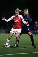 Leah Williamson of Arsenal and Mollie Green of Manchester Utd during Arsenal Women vs Manchester United Women, FA WSL Continental Tyres Cup Football at Meadow Park on 7th February 2019