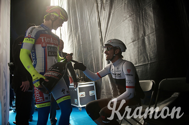 backstage fun: Peter Sagan (SVK/Tinkoff-Saxo) shows Fabian Cancellara (SUI/TREK Factory Racing) the XXL bottle of personalized Kwaremont beer he just received on the start podium<br /> <br /> 58th E3 Harelbeke 2015