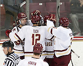 Zach Sanford (BC - 24), Alex Tuch (BC - 12), Adam Gilmour (BC - 14) and Ian McCoshen (BC - 3) celebrate Gilmour's goal. - The Boston College Eagles defeated the visiting Merrimack College Warriors 2-1 on Wednesday, January 21, 2015, at Kelley Rink in Conte Forum in Chestnut Hill, Massachusetts.