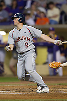 Auburn Tigers designated hitter Patrick Savage #9 follows through on his swing against the LSU Tigers in the NCAA baseball game on March 22nd, 2013 at Alex Box Stadium in Baton Rouge, Louisiana. LSU defeated Auburn 9-4. (Andrew Woolley/Four Seam Images).