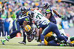 Seattle Seahawks linebackers Michael Wagner (54) and O.Brien Schofield (93) stop Green Bay Packers running Eddie Lacy (27) for a three-yard loss during the NFC Championship game at CenturyLink Field in Seattle, Washington on January 18, 2015.  The Seattle Seahawks beat the Green Bay Packers in overtime 28-22 for the NFC Championship Seattle  ©2015. Photo by Jim Bryant.  All Rights Reserved.