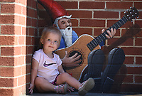 Addison Cash, 16 months, sits in the shade Thursday, June 25, 2020, with a guitar playing gnome painted on the wall by artist Jason Jones on the square in Fayetteville. Addison was with her family taking a discovery field trip to get some exercise outside of their home. Check out nwaonline.com/200626Daily/ and nwadg.com/photos for a photo gallery.<br /> (NWA Democrat-Gazette/David Gottschalk)