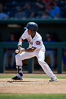 Jacksonville Jumbo Shrimp Magneuris Sierra (18) lays down a bunt base hit during a Southern League game against the Tennessee Smokies on April 29, 2019 at Baseball Grounds of Jacksonville in Jacksonville, Florida.  Tennessee defeated Jacksonville 4-1.  (Mike Janes/Four Seam Images)