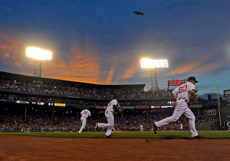 Members of the Boston Red Sox take the field against the Chicago White Sox at Fenway Park on Wednesday, July 09, 2014. Photo by Christopher Evans