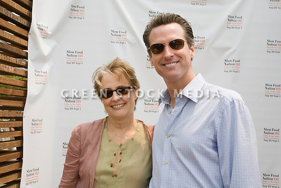 """Alice Waters, chef and founder/co-owner of Chez Panisse and San Francisco Mayor Gavin Newsom at Community Planting Day (July 12, 2008) of the Slow Food Nation Victory Garden at San Francisco's Civic Center. The garden project """"demonstrates the potential of a truly local agriculture practice that unites and promotes Bay Area urban gardening organizations, while producing high quality food for those in need.""""* The garden is planted on the same site as the post-World War II garden sixty years ago. The food will be grown over a period of two months, harvested, and donated to people in need..*slowfoodnation.org"""