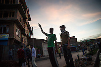 Srinagar, India-August 9, 2010: Kashmiri protesters discuss during a stand-off with police and military in downtown Srinagar